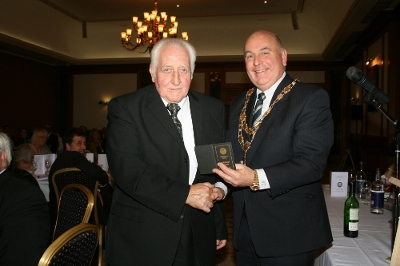 Campbell Lyon (left) receiving his lifemembership certificate